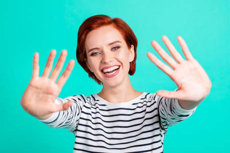 Close up portrait of cheerful foxy attractive she her lady palms up showing numeral statistics learning studying in class wearing white striped pullover isolated on teal green background