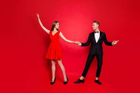 Full length body size portrait of two graceful slim attractive couple