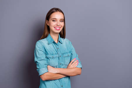 Close up portrait of crossed hands smiling standing young woman