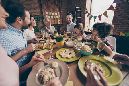 cheerful family eating together Stock Photo