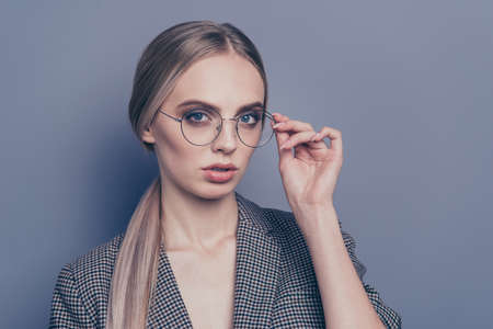 Close up photo of attractive active profession she her lady hand on specs adjust looking seriously to camera just started career wearing formalwear checkered strict jacket isolated on grey background