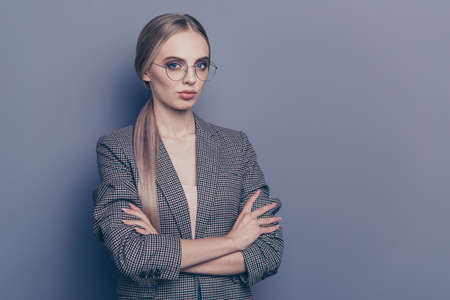 Close up photo of attractive self-confident she her lady got succeed in working took salary increase wearing specs formalwear checkered strict jacket isolated on grey background Imagens