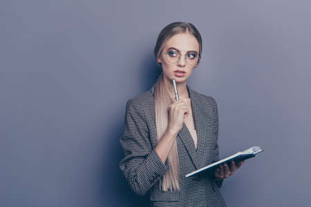 Close up photo of pretty she her lady assistant listening interested going to write down pencil on chin looking to empty space wearing specs formalwear checkered blazer isolated on grey background