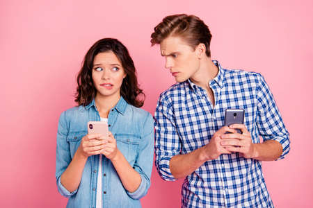 Photo of busy couple with telephones Stock Photo