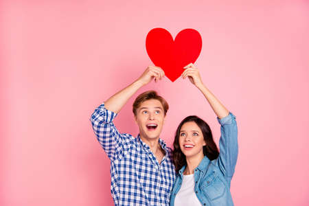 Young couple holding heart shaped