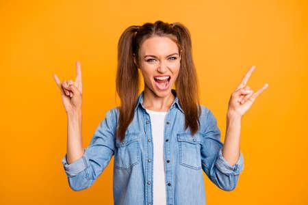 A young women showed rock style gesture Reklamní fotografie