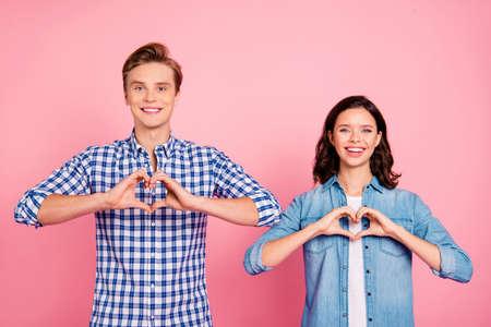 A sweet couple showed love heart gesture