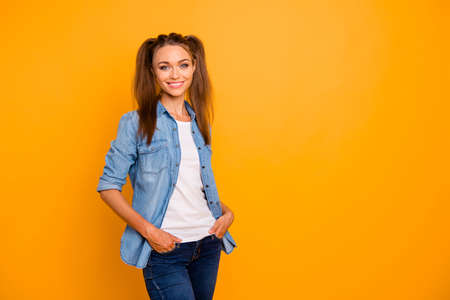 Attractive girl looking at the camera on a yellow background
