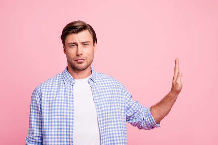 Portrait of his he nice confident attractive handsome candid guy wearing checked shirt showing stop gesture aside isolated over pink pastel background Stock fotó
