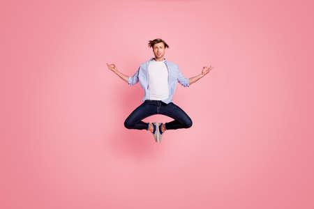 Full length body size photo of jumping high crazy he his him handsome holding hands arms fingers lotus shape figure wearing casual jeans checkered plaid shirt isolated on rose background Stok Fotoğraf