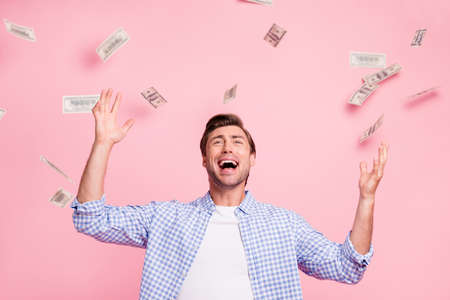 Portrait of his he nice funny attractive handsome cheerful cheery guy wearing checked shirt money flying in air rejoicing celebrating isolated over pink pastel background Stock Photo