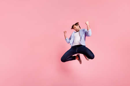 Full length body size photo of jumping high crazy he his him handsome oh no expression fall down epic lost break down wearing casual jeans checkered plaid shirt isolated on rose background