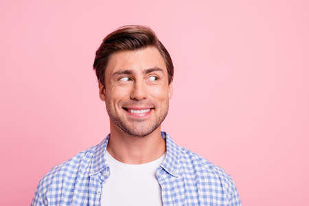 Close up photo of amazing he him his man looking with wonder to empty space decided to make not good thing wearing casual plaid shirt outfit isolated on pale rose background Stock fotó