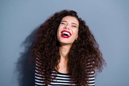 Close-up portrait of her she nice cute gorgeous glamorous fascinating attractive cheerful wavy-haired lady laughing out crazy isolated over gray pastel background