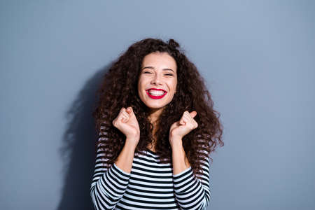 Close up photo portrait of pretty cute sweet dreamy lovely delightful nice glad carefree person people lady showing raise fists isolated grey background copyspace