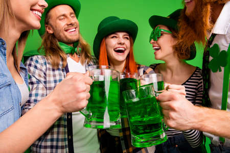 Close-up view of nice attractive cheerful cheery positive people guys ladies in costumes trendy stylish look clinking jar craft ale having fun in pub vacation isolated bright vivid shine background