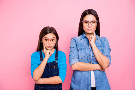 Portrait of two nice trendy cute pretty lovely attractive charming suspicious funny curious straight-haired girls touching cheek guessing isolated over pink pastel background Imagens - 116561130