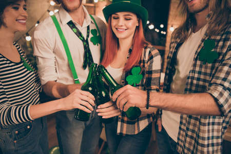Close up photo company together st paddy day leprechaun costumes telling toast irish tradition culture carefree guys best weekend vacation hands raise beer bottles festive