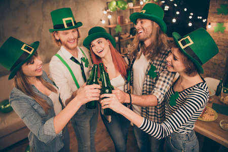 Irish national tradition holiday festive st paddy day five members company in decorated flat room apartment house green beer beverage good toasting buddies get every word humor comic joke weekend