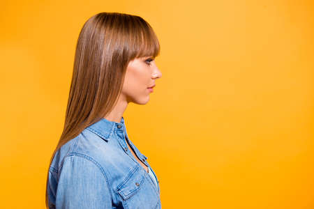 Close up side profile portrait amazing attractive beautiful she her lady confidently look to empty space not smiling wearing casual jeans denim shirt clothes isolated on yellow background 写真素材