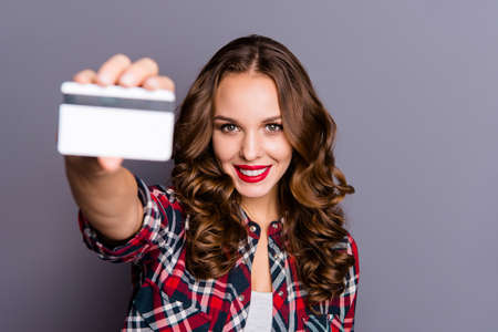 Close up portrait of beautiful amazing she her lady arm hold advice credit card bank novelty feedback take it closer to camera help see wearing casual checkered plaid shirt isolated grey background