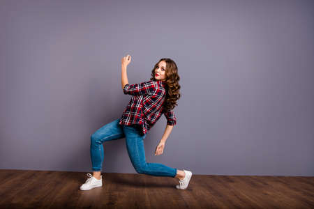 Full length size body view photo fly high amazing attractive beautiful she her lady modern crazy dance like flight up in air wearing casual jeans denim checkered plaid shirt grey background 写真素材