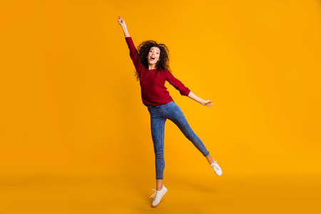 Full length body size view of her she nice lovely attractive cheerful funny slim thin fit wavy-haired lady vacation weekend holding invisible umbrella isolated bright vivid shine orange background.
