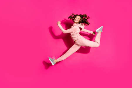 Full length body size photo jumping flight high smiling amazing she her lady hands arms help rushing shopping wearing modern casual pink costume suit pullover outfit isolated vibrant rose background