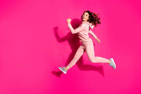 Full length body size photo flight high amazing she her lady hands arms help rush shopping wide steps funny funky wearing casual pink costume suit pullover outfit isolated vibrant rose background