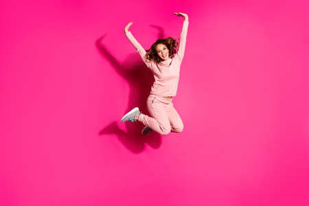 Full length body size photo flight high amazing she her lady hands arms help fly arms up like child wearing casual pink costume suit pullover outfit isolated vibrant rose background