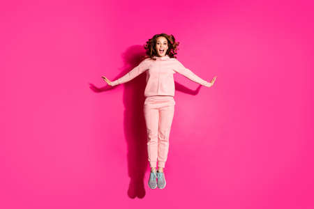 Full length body size photo jump high amazing she her lady hands arms flirty raised cute sweet wearing casual pink costume suit pullover outfit isolated vibrant rose background