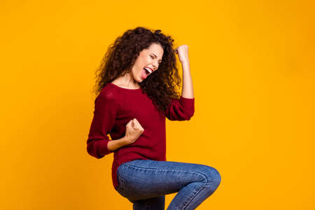 Close up photo amazing beautiful her she lady all possible just keep believe yell voice raised fists hip delight like guitar wear red knitted sweater pullover clothes outfit isolated yellow background