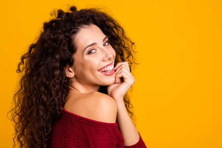 Close up side profile view photo amazing her she lady arm touch chin nude naked shoulder revealed teeth playful look wearing red knitted sweater pullover clothes outfit isolated yellow background Banque d'images - 117641942