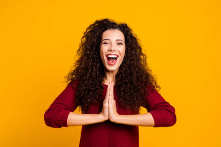 Close up photo beautiful cheerful amazing her she lady showing devotion issue glad attend yoga training friendly smile wearing red knitted sweater pullover clothes outfit isolated yellow background