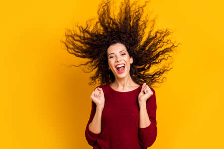 Close up photo amazing charming her she lady hair flight warm weather yell scream shout lucky free trip abroad voyage wearing red knitted sweater clothes outfit isolated yellow bright background Stock Photo