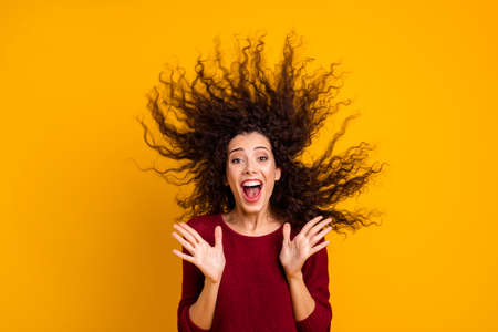 Close up photo amazing charming her she lady hair flight yell scream shout free trip abroad unexpected unbelievable wearing red knitted sweater clothes outfit isolated yellow bright background Banco de Imagens