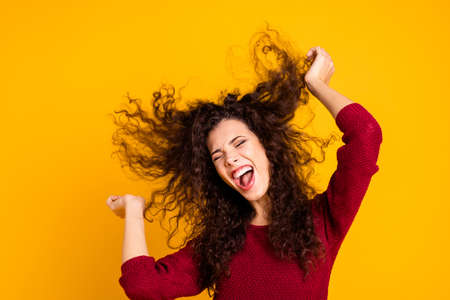 Close up photo amazing charming her she lady hair flight warm weather be yourself yelling with good mood songs wearing red knitted sweater clothes outfit isolated yellow bright background