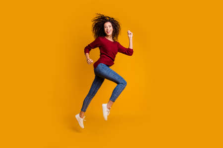 Full length body size view of her she nice-looking lovely pretty attractive cheerful cheery sportive slim fit wavy-haired lady running strive purpose isolated on bright vivid shine orange background