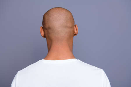 Close up back behind rear view photo dark skin he him his man turned to empty space distracted unrecognizable groomed shaved head wearing white t-shirt outfit clothes isolated on grey background Imagens - 118003605