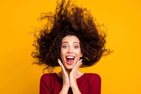 Close up photo amazing charming her she lady hair flight yelling loud funky good news summer weekend vacation mood wearing red knitted sweater clothes outfit isolated yellow bright background Archivio Fotografico