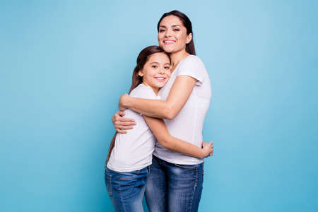 Close up photo adorable amazing pretty two people brown haired mum small little daughter stand close lovely holding hands arms circle rejoice wearing white t-shirts isolated on bright blue background Stock Photo - 118004855