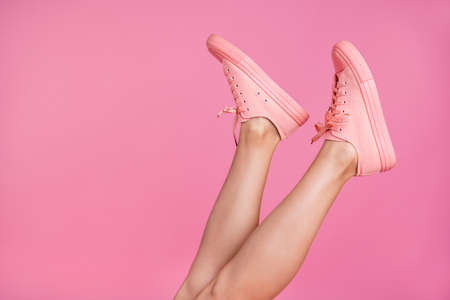 Cropped close-up image view photo of nice attractive feminine fit thin slim shaven legs active sport walk go steps trendy foot-wear isolated over pink pastel background