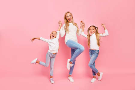 Full length size body portrait of nice cute attractive charming cheerful cheery kind people mom mum mommy holding hands spending free time isolated over pink pastel background Foto de archivo