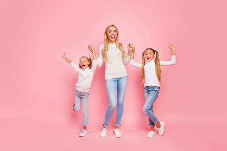 Full length size body portrait of nice cute attractive charming lovely lovable cheerful cheery kind people mom mum holding hands spending free spare time isolated over pink pastel background