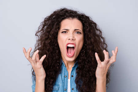 Close up photo yelling amazing attractive her she lady not satisfied with tv news end film movie serial show hands arms in air wearing casual jeans denim shirt clothes outfit isolated grey background