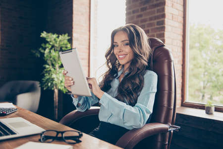 Close up photo beautiful she her business lady best boss see progress according reports team meeting working on startup agreement investors sit big office chair  wearing specs formal wear suit shirt Imagens