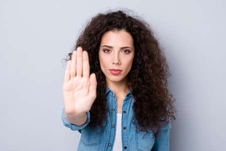 Close up photo amazing beautiful her she lady arm up you will not pass through not allow killing animals make cosmetics wearing casual jeans denim shirt clothes outfit isolated grey background