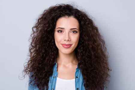 Close up photo of amazing attractive smiling gladly modern her she lady with long wave wealth of hair wearing casual jeans denim shirt clothes outfit isolated on grey background Imagens - 117892572
