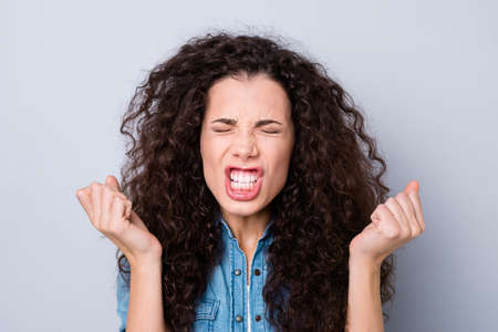 Close up photo yelling amazing attractive her she lady not satisfied hands arms in air eyes closed tight try not cry wearing casual jeans denim shirt clothes outfit isolated grey background Foto de archivo - 117892440