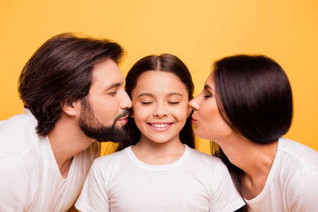 Close-up portrait of nice cute lovely lovable attractive charming cheerful people mom dad pre-teen adopted foster girl isolated over shine vivid pastel yellow background Banco de Imagens